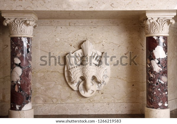 Toronto, Ontario, Canada - July 30, 2017: Carved marble dove symbol of the Holy Spirit of God at the tabernacle altar with corinthian columns at a Toronto Roman Catholic church