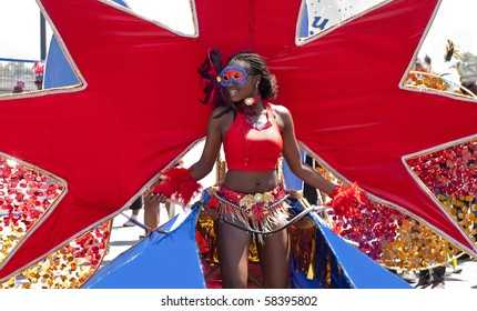 TORONTO, ONTARIO, CANADA - JULY 31: Unidentified Caribana dancer in red costume walks during parade on July 31, 2010 in Toronto, Ontario, Canada.