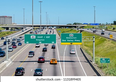 Toronto, Ontario, Canada - July 8th 2018: a view of Highway 401 facing east at Don Mills Road in North York. This highway is among the busiest in all of North America.