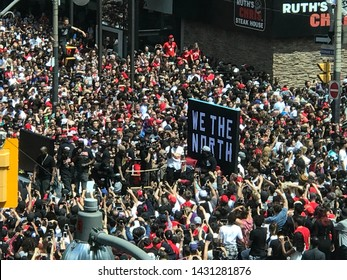 Toronto, Ontario / Canada - June 17 2019: People gathering for Toronto Raptor's NBA championship parade in Toronto downtown.