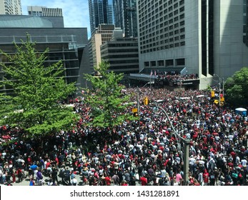 Toronto, Ontario / Canada - June 17 2019: People gathering for Toronto Raptor's NBA championship parade in Toronto downtown.