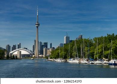 Toronto, Ontario, Canada - June 19, 2014: Toronto skyline and Island Yacht Club sailboats from Blockhouse Bay between Hanlan and Muggs Islands