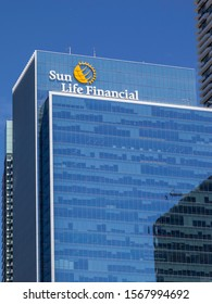 Toronto, Ontario, Canada - June 19, 2018: Sign and logo of Sun Life Financial, Inc. on the building of head office, a Canada-based financial services company.