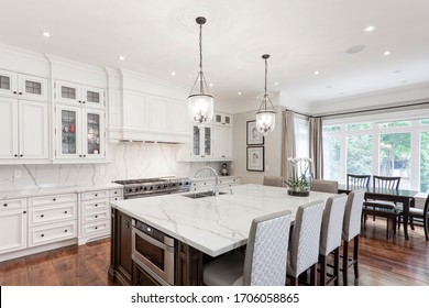 Toronto, Ontario / Canada -  June 25, 2018: A modern white kitchen with a traditional touch custom designed by Toronto interior designer Tracy Barber.