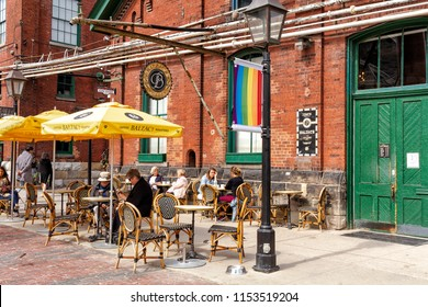 Toronto, Ontario, Canada - June 6, 2018: The Distillery District, the old Gooderham and Worts, is a national historic site that encompass cafes, restaurants, shops and art galleries.