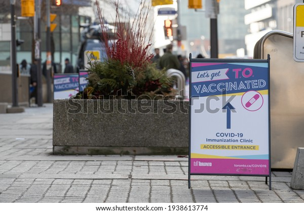 TORONTO, ONTARIO, CANADA - MARCH 18, 2021: SIGNAGE DIRECTING PEOPLE TO WHERE TO RECEIVE THEIR COVID-19 VACCINE AT METRO CONVENTION CENTRE.