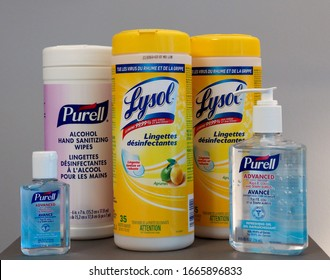 """Toronto, Ontario / Canada - March 6, 2020: Lysol disinfecting wipes and Purell alcohol hand sanitizer. Cleaning supplies stockpile. Label description in FRENCH LANGUAGE """"Lingettes desinfectantes""""."""