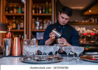 TORONTO, ONTARIO, CANADA - MARCH 6, 2018: BARTENDER PREPARES DRINKS.