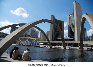 Toronto, Ontario / Canada - May 13, 2016 : Nathan Phillips Square  with Toronto Sign and old City Hall Building