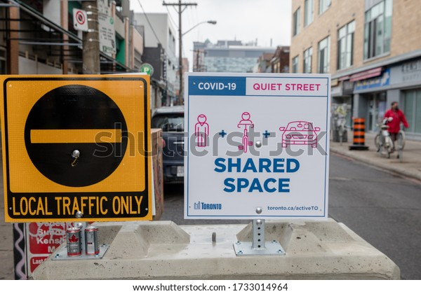 TORONTO, ONTARIO, CANADA - MAY 15, 2020: Shared space sign as part of ACTIVE TO initiative. ActiveTO is about making sure people have space to get around while respecting physical distancing during CO