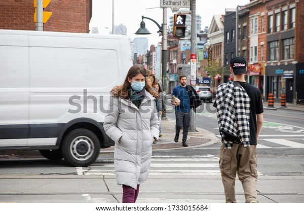 TORONTO, ONTARIO, CANADA - MAY 15, 2020: PEOPLE WEAR FACE MASKS DURING COVID-19 PANDEMIC.