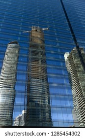 Toronto, Ontario, Canada - May 31, 2014: Reflections of new condominium development in glass of PwC tower office building Toronto