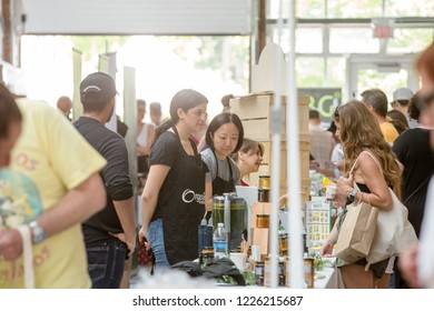 TORONTO, ONTARIO, CANADA - MAY 5, 2018: PEOPLE ATTENDING EVENT AND VENDORS WORKING EVENT HELD AT WYCHWOOD BARNS.