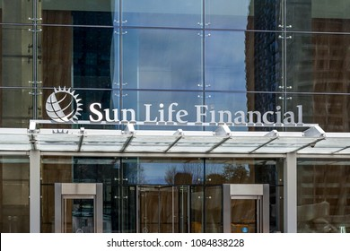 Toronto, Ontario, Canada - May 5th, 2018: Sign of Sun Life Financial, Inc. on the building of head office, a Canada-based financial services company.