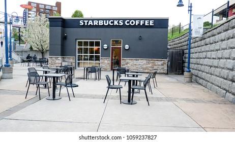 Toronto Ontario Canada , May 9th 2017. View of outdoor sitting table STARBUCKS COFFE SHOP at Niagara falls Canada.