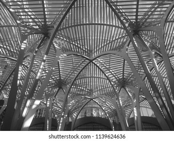 Toronto, Ontario / Canada – November 10, 2017: Black and white shot of a ceiling containing intertwining steel arches at Sam Pollock Square, within Toronto's famous Brookfield Place.
