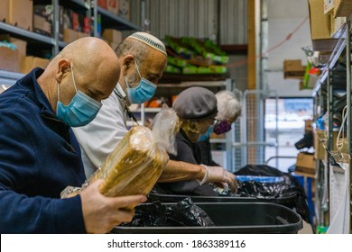 TORONTO, ONTARIO, CANADA - NOVEMBER 25, 2020: PEOPLE WORK AT JEWISH FOOD BANK, PREPARING FOOD FOR FAMILIES IN NEED OF HELP DURING COVID-19 PANDEMIC.