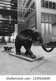 Toronto, Ontario / Canada – November 9, 2017: Black and white shot of a set of bronze elephant sculptures in the middle of the financial district in a courtyard in Commerce Court in downtown Toronto.