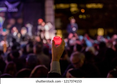 TORONTO, ONTARIO, CANADA - OCTOBER 29, 2018: People hold up lit candles at vigil held by Toronto Jewish Community for victims of Pittsburgh Synagogue Massacre