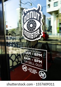 Toronto, Ontario / Canada - October 29 2019: Sign for Donut Monster, a popular local chain that bakes amazing, high quality donuts from scratch, in a variety of unique seasonal flavours.