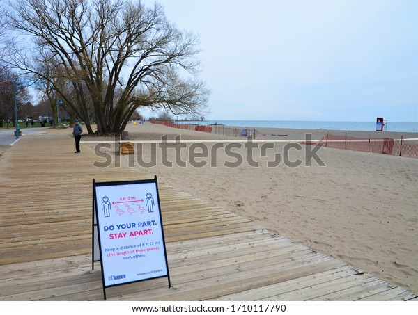 Toronto, Ontario, Canada on April 15, 2020.  The social distancing sign by the city officials during the Covid-19 pandemic in The Beach, a popular outdoor destination in the east end of the city.