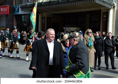 Toronto, Ontario, Canada on March 11, 2018.  Mr. Doug Ford, the newly elected leader of Conservative Party joined the crowd during the Saint Patrick Day Parade in the city.