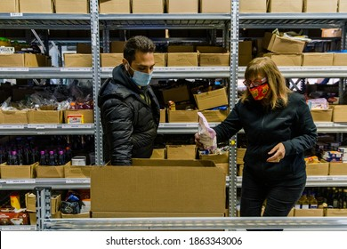 TORONTO, ONTARIO, CANADA - PEOPLE WORK AT JEWISH FOOD BANK, PREPARING FOOD FOR FAMILIES IN NEED OF HELP DURING COVID-19 PANDEMIC.