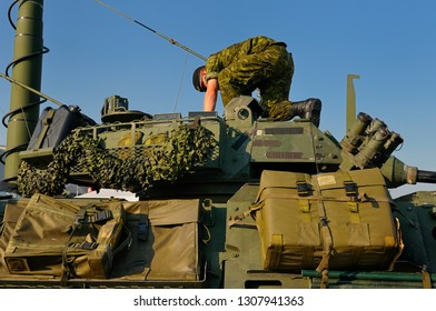 Toronto, Ontario, Canada - September 1, 2010: Soldier reaching into the gun turret of a green Canadian army light armoured vehicle