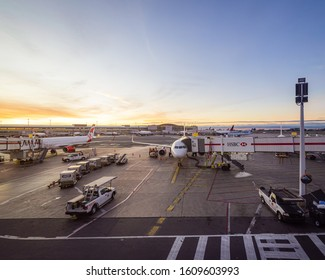Toronto, Ontario / Canada - September 29, 2019: Dawn breaks over the tarmac at Toronto's Pearson International Airport as Air Canada passenger jets are readied for the day's travel.