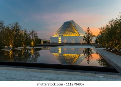Toronto, Ontario / Canada - September 5, 2017: The Aga Khan Museum in Toronto, Ontario at twilight with pond reflections.