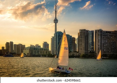 Toronto, Ontario, Canada -September14, 2012: Boats sailing into Toronto Inner Harbour at sunset with the Downtown City Skyline in the background.