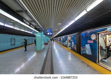 Toronto, Ontario, Canada-December 12, 2018: TTC train painted with advertisement about Becel margarine. It is seen in York Mills Station. The scene is common in the public transportation system