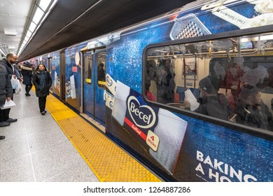 Toronto, Ontario, Canada-December 12, 2018: TTC Bombardier train spotted in Saint George subway station. The vehicle is painted with Becel Margarine advertisement