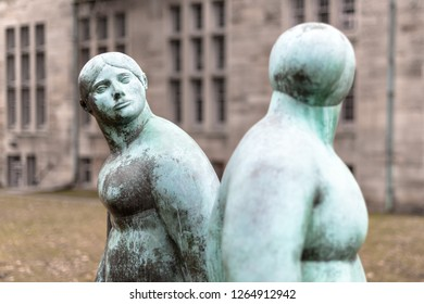 Toronto, Ontario, Canada-December 12, 2018: Statue of two beautifully overweight women looking at each other. It is located in the grounds of the Saint Michael's College.