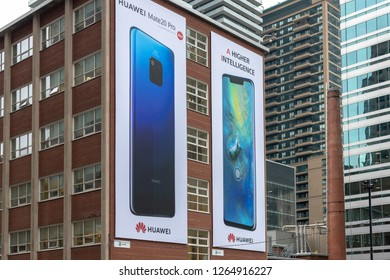 Toronto, Ontario, Canada-December 12, 2018:Huawei smartphones being advertised in a city corner.  Canada and China are currently involved in intense diplomatic meetings dealing with the detention Meng