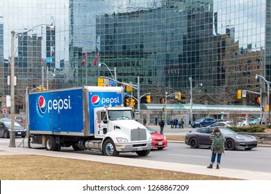 Toronto, Ontario, Canada-December 9, 2018:  large Pepsi Cola truck is parked in the intersection of University Avenue and College Street. Sales of carbonated drinks keep going down for health concerns