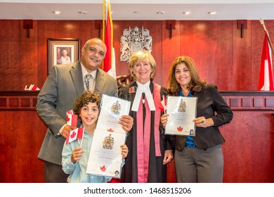 Toronto, Ontario, Canada-July 1, 2019: Hispanic family becomes Canadian citizens.Canadian nationality law determines who the citizenship is granted to.