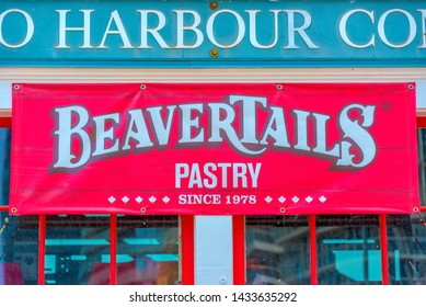 Toronto, Ontario, Canada-June 5, 2015: The Beaver Tails cafeteria facade details. A Beaver Tail is a Canadian traditional pastry. The building is located in the harborfront and is a tourist attraction
