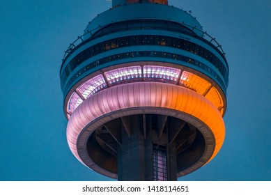 Toronto, Ontario, Canada-May 24, 2019: The CN Tower during the dusk hours. The landmark building is considered one of the marvels of the modern world. It is a symbol of Canada.