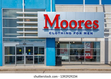 Toronto, Ontario, Canada-May 6, 2019: Moores Clothing for Men store sign at entrance. Moores is a Canadian brand specialized in tailor-made clothing for men similar to Tip Top Tailors.