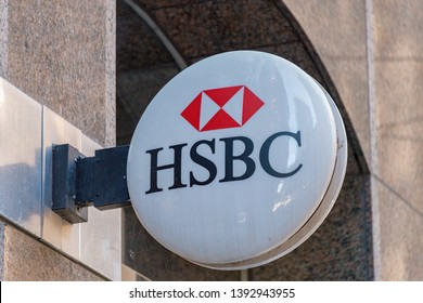 Toronto, Ontario, Canada-May 6, 2019: HSBC signage fixed to a wall. HSBC Holdings PLC is a British multinational banking and financial services company headquartered in London.