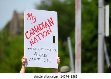 Toronto, Ontario - July 1, 2019: A demonstrator shows distaste for Ontario premier Doug Ford at a Canada Day event he cancelled but was taken over by Liberal MPP Mitzie Hunter.
