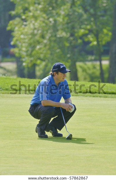 TORONTO, ONTARIO - JULY 21 : South African golfer Tim Clark lines up a putt during a pro-am event at the RBC Canadian Open golf on July 21, 2010 in Toronto, Ontario.