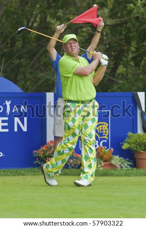 TORONTO, ONTARIO - JULY 21: US golfer John Daly follows his tee shot during a pro-am event at the RBC Canadian Open golf, St. George's; Golf and Country Club; Toronto, Ontario, July 21, 2010