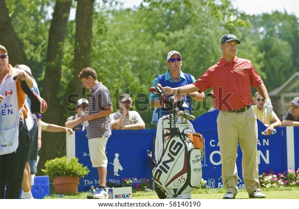 TORONTO, ONTARIO - JULY 21: US golfer Chris DiMarco selects a club during a pro-am event at the RBC Canadian Open golf, St. George's; Golf and Country Club on July 21, 2010 in Toronto, Ontario.