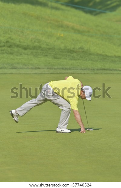 TORONTO, ONTARIO - JULY 21:English golfer Paul Casey picks up his ball after putting during a pro-am event at the RBC Canadian Open golf on July 21, 2010 on Toronto, Ontario.