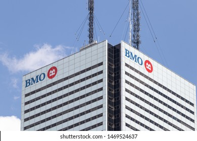 TORONTO, ONTARIO - July 24, 2019: Top of First Canadian Place skyscraper in downtown Toronto with BMO (Bank of Montreal) logo seen on each side.