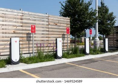 TORONTO, ONTARIO - July 26, 2019: Tesla Urban Supercharger Stations empty at CF Sherway Gardens Mall in Toronto, Ontario.
