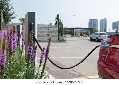 TORONTO, ONTARIO - July 26, 2019: Tesla Model S plugged into Tesla Urban Supercharger at CF Sherway Gardens in Toronto (Etobicoke).