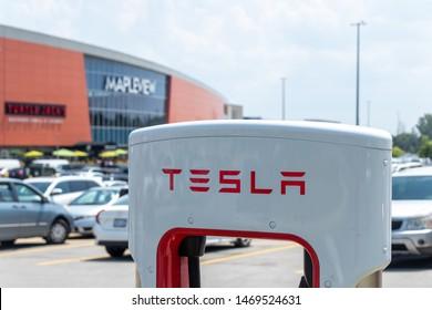 TORONTO, ONTARIO - July 26, 2019: Tesla text logo atop of Supercharger Stall at Burlington Mapleview Mall.